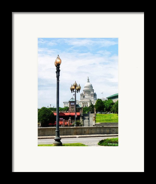 Capitol Building Seen From Waterplace Park Framed Print By Susan Savad