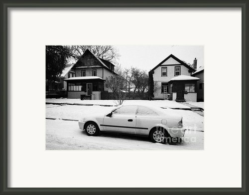 Car Covered In Snow Parked By The Side Of The Street In Front Of Residential Homes Caswell Hill Sask Framed Print By Joe Fox