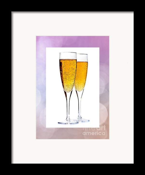 Champagne In Glasses Framed Print By Elena Elisseeva
