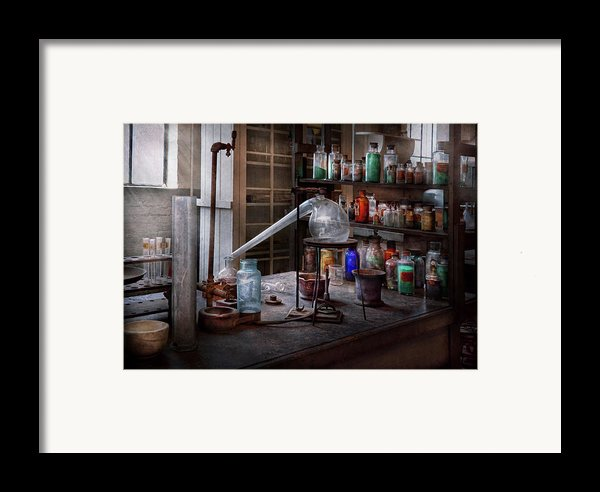 Chemist - My Retort Is Better Than Yours  Framed Print By Mike Savad