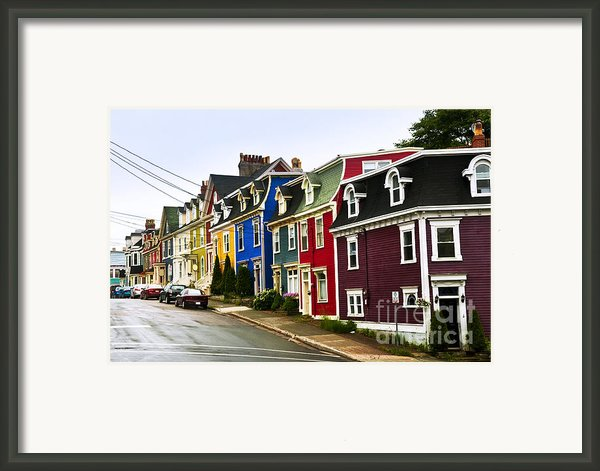 Colorful Houses In Newfoundland Framed Print By Elena Elisseeva
