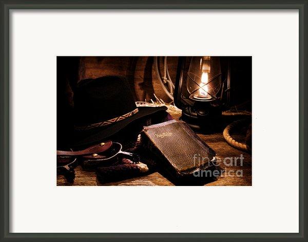 Cowboy Bible Framed Print By Olivier Le Queinec