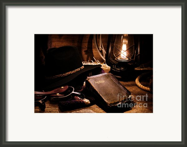 Cowboy Bible Framed Print By Olivier Le Queinec