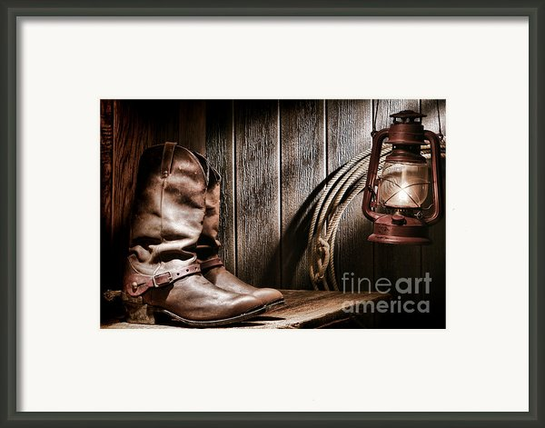 Cowboy Boots In Old Barn Framed Print By Olivier Le Queinec