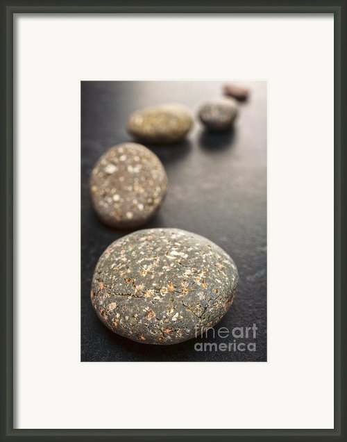 Curving Line Of Speckled Grey Pebbles On Dark Background Framed Print By Colin And Linda Mckie