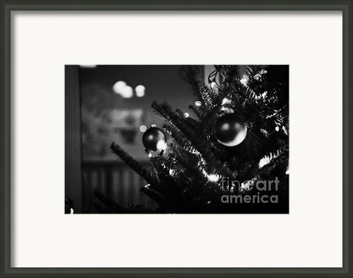 Decorated Christmas Tree Looking Out Of Window To Snow Covered Scene In Small Rural Village Of Forge Framed Print By Joe Fox