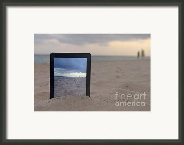 Digital Tablet In Sand On Beach Framed Print By Sami Sarkis