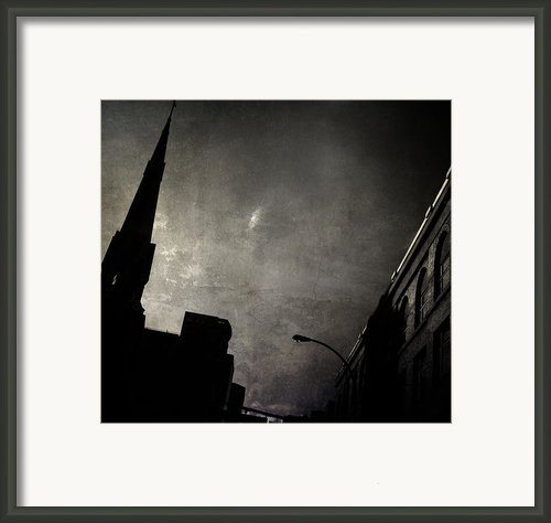 Divided  By Belief  Framed Print By Jerry Cordeiro