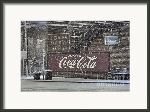 Downtown Covered In Snow Framed Print By Benanne Stiens