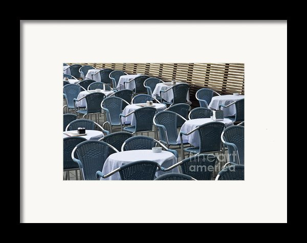 Empty Restaurant Seats And Tables Framed Print By Sami Sarkis