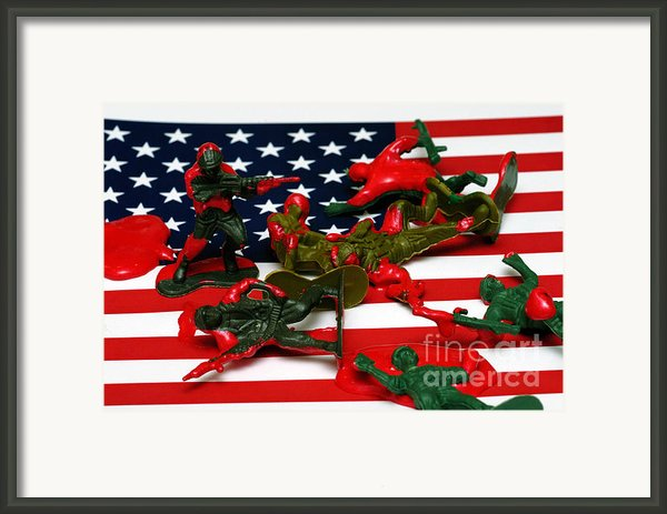 Fallen Toy Soliders On American Flag Framed Print By Amy Cicconi