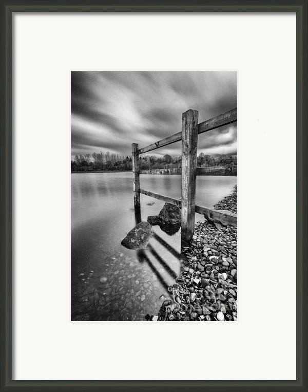 Fence In The Loch  Framed Print By John Farnan