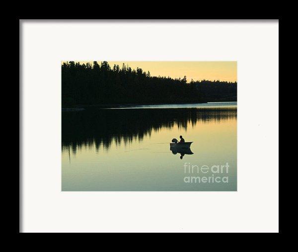 Fisherman At Dusk Framed Print By Nancy Harrison