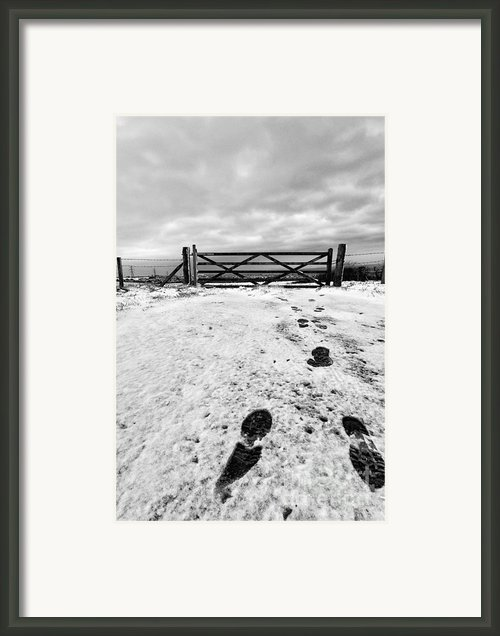 Footprints In The Snow Framed Print By John Farnan