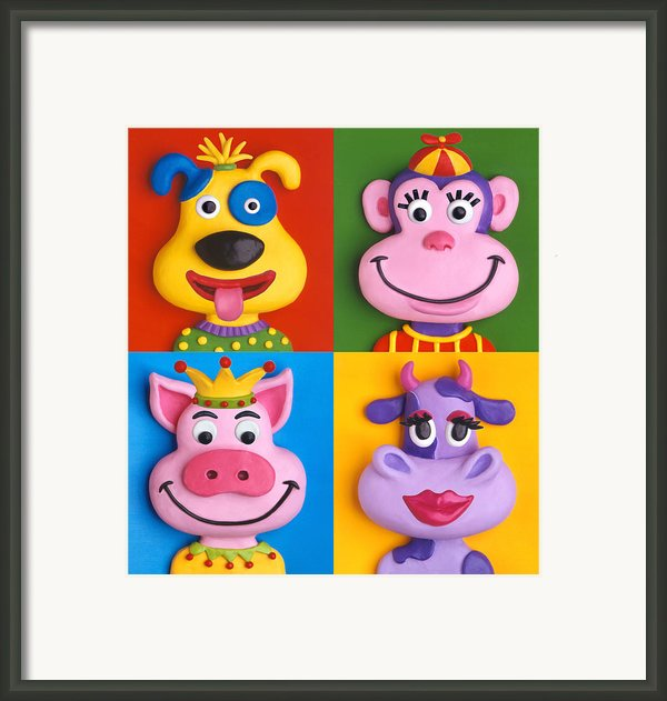 Four Animal Faces Framed Print By Amy Vangsgard