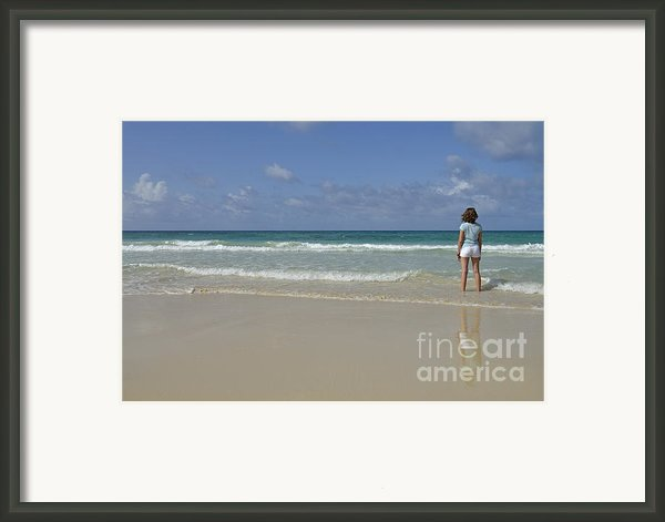Girl Contemplating Ocean From Beach Framed Print By Sami Sarkis