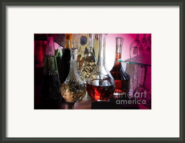 Glass Decanters Framed Print By Kathleen Struckle