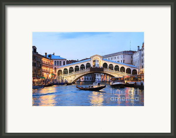 Gondola In Front Of Rialto Bridge At Dusk Venice Italy Framed Print By Matteo Colombo