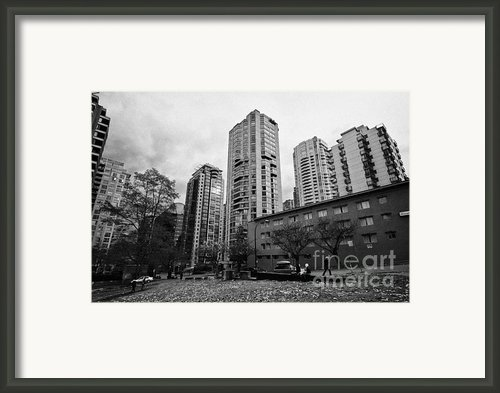 Green Space In Front Of High Rise Apartment Condo Blocks In The West End Between Robson And West Geo Framed Print By Joe Fox