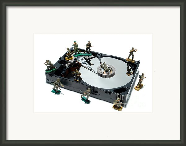 Hard Drive Defense  Framed Print By Olivier Le Queinec