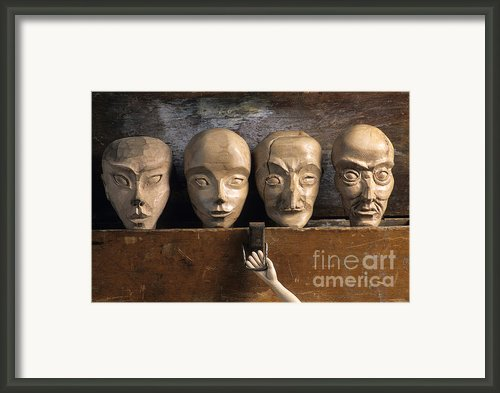Heads Of Wooden Puppets Framed Print By Bernard Jaubert