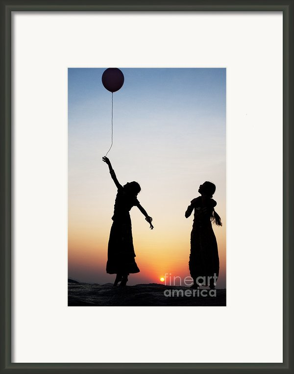 Holding The Dream Framed Print By Tim Gainey