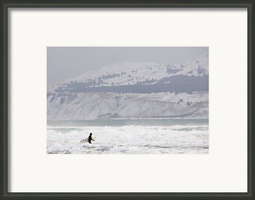 Into The Winter Surf Framed Print By Tim Grams