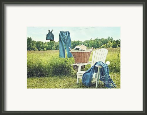 Jeans Hanging On Clothesline On A Summer Afternoon Framed Print By Sandra Cunningham