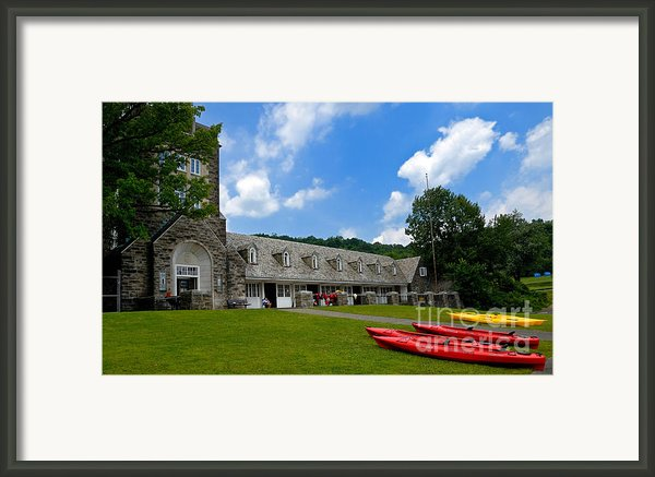 Kayaks At Boat House Framed Print By Amy Cicconi