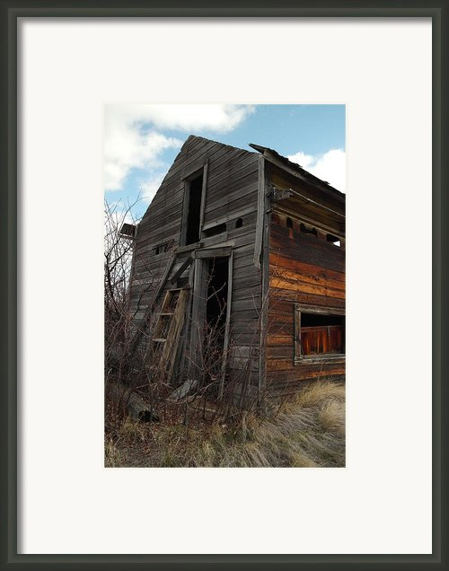 Ladder Against A Barn Wall Framed Print By Jeff  Swan