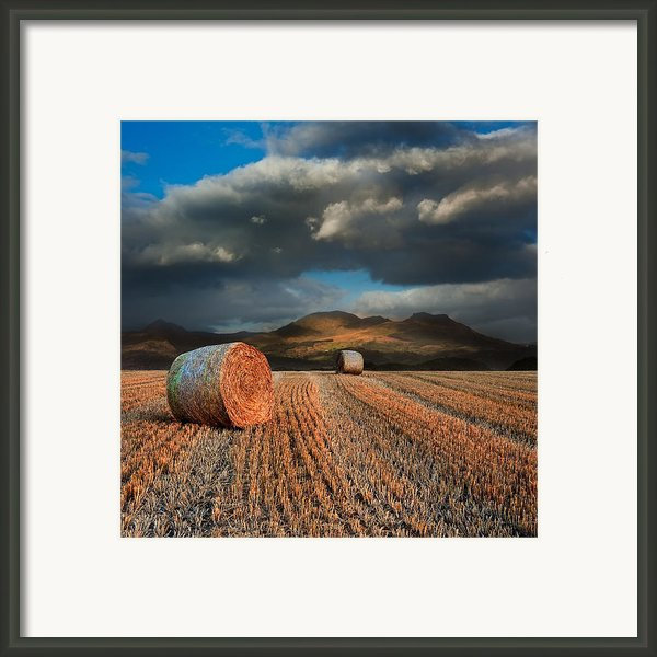 Landscape Of Hay Bales In Front Of Mountain Range With Dramatic  Framed Print By Matthew Gibson