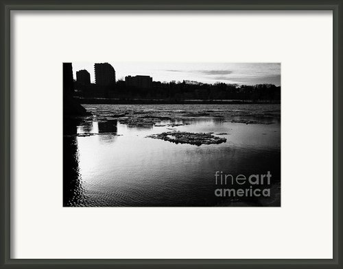 Large Chunks Of Floating Ice On The South Saskatchewan River In Winter Flowing Through Downtown Sask Framed Print By Joe Fox