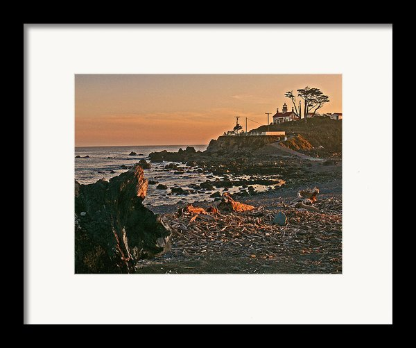 Lighthouse Sunset  Framed Print By Gracia  Molloy