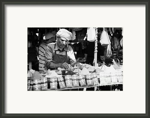 Local Arab Man Measuring Out A Quantity Of Spice For Sale On Stall Of Spices At The Market In Nabeul Tunisia Framed Print By Joe Fox