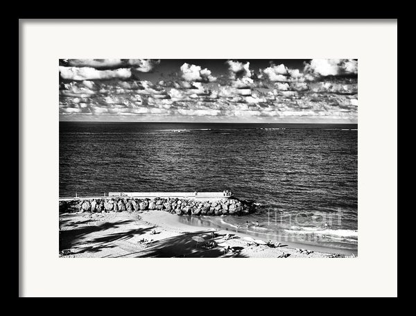 Looking Out Into The Ocean Framed Print By John Rizzuto