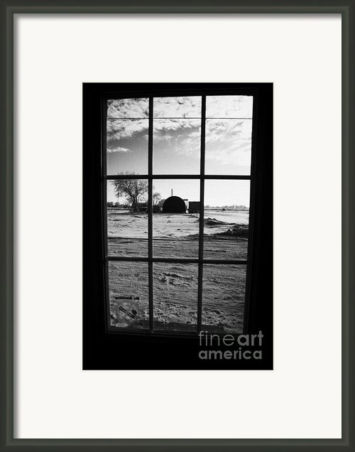 Looking Out Through Door Window To Snow Covered Scene In Small Rural Village Of Forget Framed Print By Joe Fox