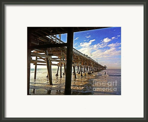 Lowtide At The Pier Framed Print By Traci Lehman