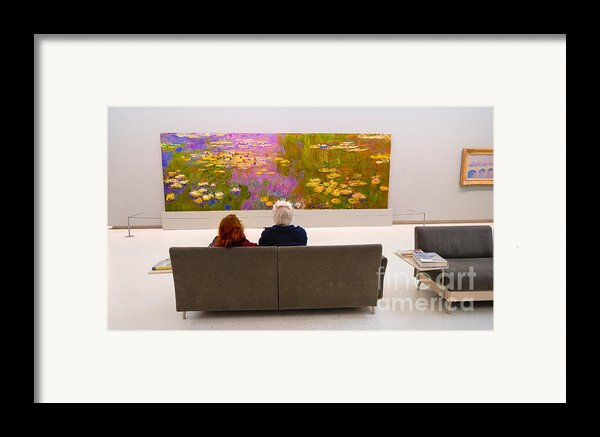 Man And Woman And Monet Painting At Carnegie Museum In Pittsburgh Pennsylvania Framed Print By Amy Cicconi