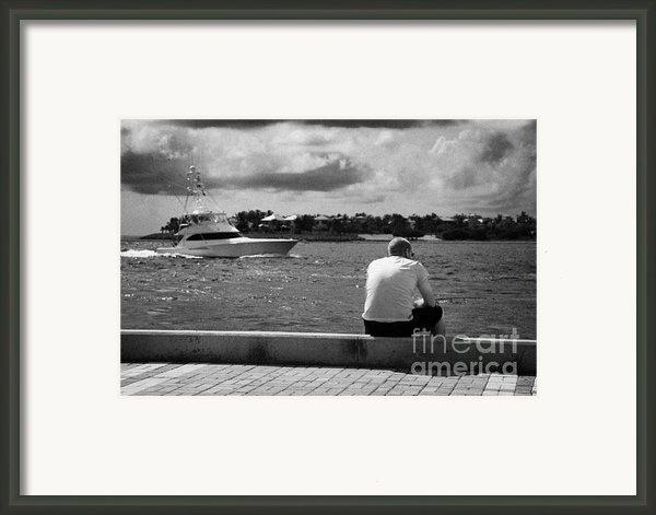 Man Fishing On Mallory Square Seafront Key West Florida Usa Framed Print By Joe Fox
