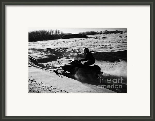Man On Snowmobile Crossing Frozen Fields In Rural Forget Saskatchewan Framed Print By Joe Fox