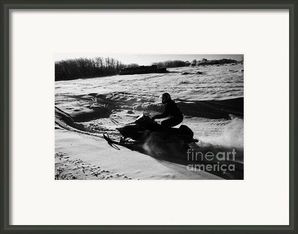 Man On Snowmobile Crossing Frozen Fields In Rural Forget Saskatchewan Framed Print By Joe Fox