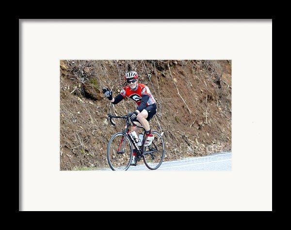 Man Riding Bike In A Race Framed Print By Susan Leggett