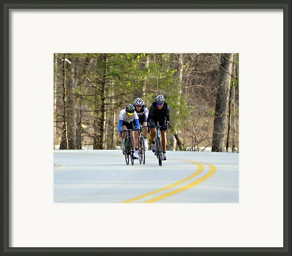 Men In A Bike Race Framed Print By Susan Leggett
