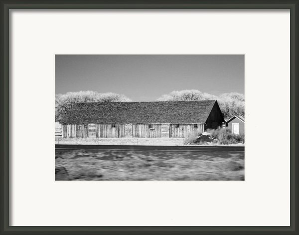 Montana Building Framed Print By Paul Bartoszek