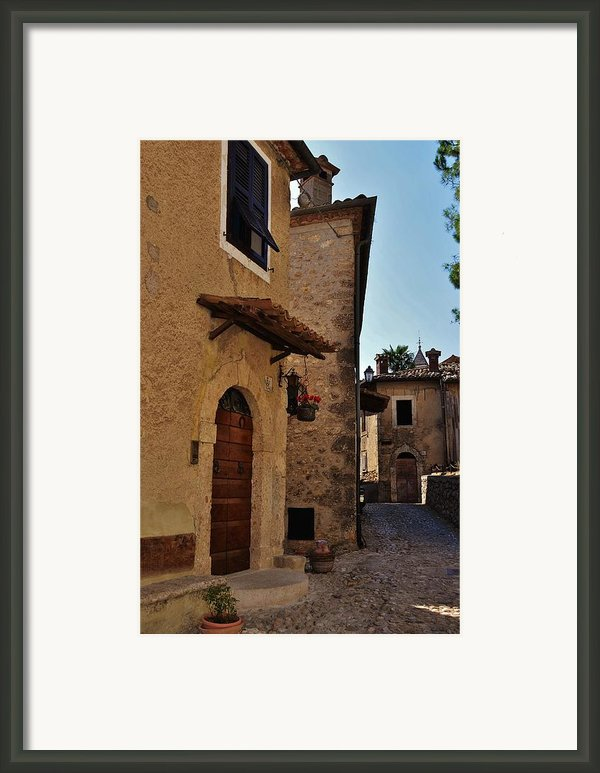 Narrow Street In Italian Village Framed Print By Dany  Lison