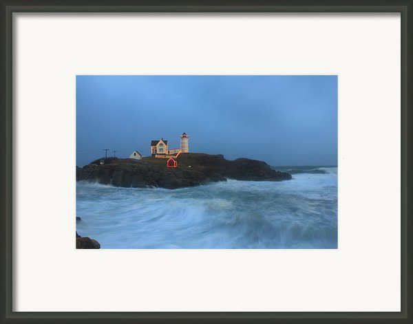 Nubble Lighthouse High Surf And Holiday Lights Framed Print By John Burk