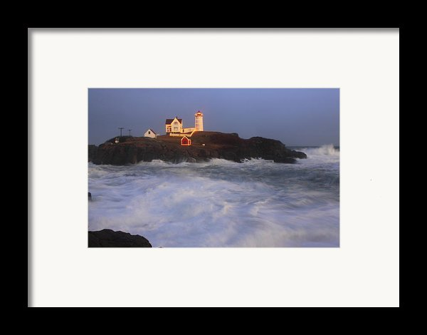 Nubble Lighthouse Holiday Lights And High Surf Framed Print By John Burk