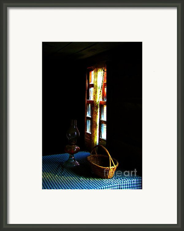 Old Cabin Table With Lamp And Basket Framed Print By Julie Dant