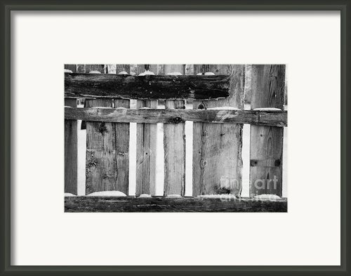 Old Patched Up Wooden Fence Using Old Bits Of Wood In Snow Forget Framed Print By Joe Fox