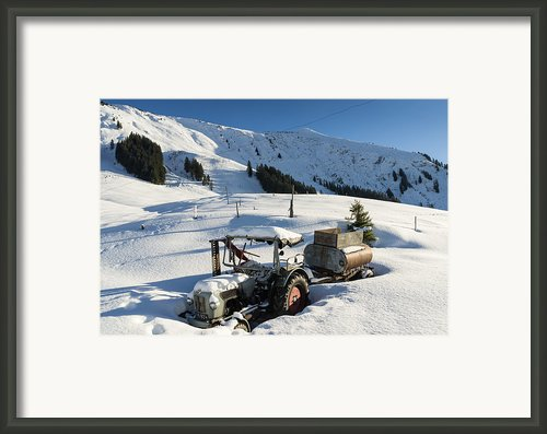 Old Tractor In Winter With Lots Of Snow Waiting For Spring Framed Print By Matthias Hauser